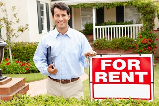 image of man outside a rental house